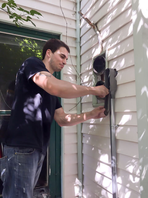 Edmonton electrician working on a residential service upgrade.